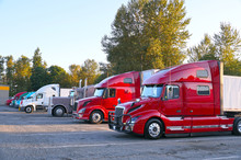 Various Types Of Trucks In The Parking Lot Next To The Motorway. Truck Stop.