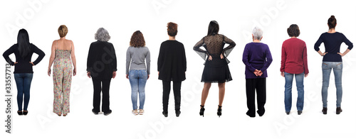 Fotografiet group of woman from behind on white background