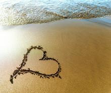 Beach. Heart Painted On Sea Sand