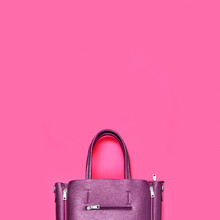Beautiful Fashionable Purple Bag On A Delicate Pink Background