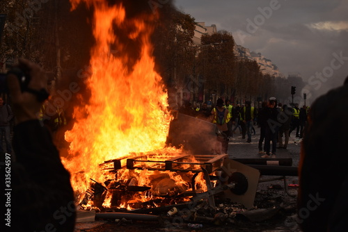 Pile of things burning on the street by yellow vest protestors in Paris France Wallpaper Mural