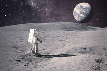 Astronaut On Rock Surface With...