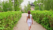 A Young Girl In A White Dress ...