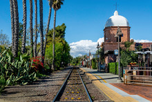 A Single Set Of Train Tracks Leads To A Vanishing Point On The Horizon At The San Juan Capistrano Train Station.