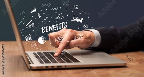 Fototapeta Businessman working on laptop with BENEFITS inscription, modern business concept obraz