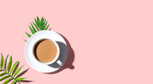 A Cup Of Coffee With Tropical Leaves - Flat Lay