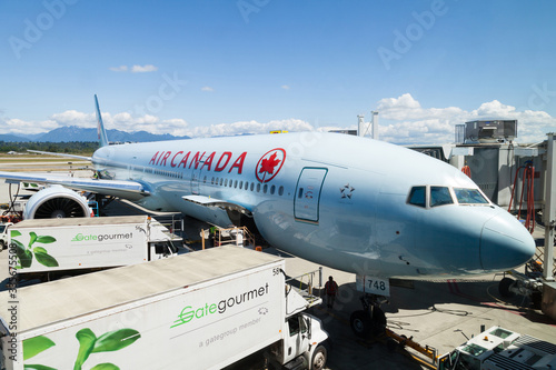 Air Canada plane being serviced on the tarmac of Vancouver International Airport