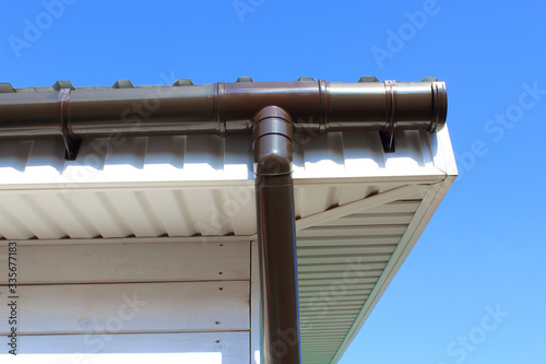 Plastic drainpipe on the roof of the house. Close-up. Background. Canvas-taulu