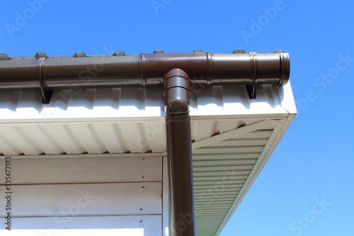 Plastic drainpipe on the roof of the house. Close-up. Background. Tapéta, Fotótapéta