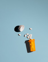 Pills Spilling Out Of A Medicine Bottle