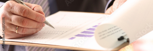 Photo Financial Auditor Signing Calculating Document
