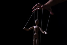 Conceptual Image Of A Hand With Strings To Control A Marionette