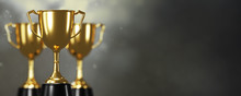 Golden Trophy Cup On Gold Back...