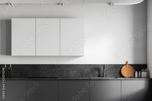 Gray kitchen countertops and white cupboards Wallpaper Mural