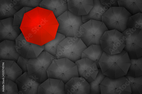 Standing out from the crowd, high angle view of red umbrella over many dark ones Canvas Print