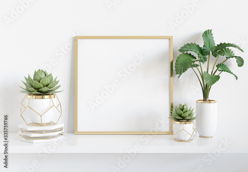 Frame leaning on white shelve in bright interior with plants and decorations moc Slika na platnu