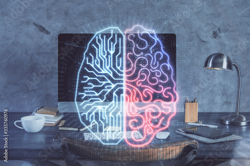 Double exposure of table with computer and brain hologram. Data innovation concept.