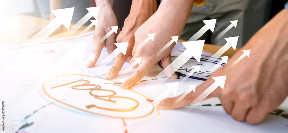 Fototapeta business successful meeting  close up business hand teamwork hand point together into goal strategy word with cheerful and confident business successful ideas concept