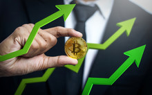 Businessman Holding Bitcoin With Green 3D Arrow Up. Bitcoin Price Going Up