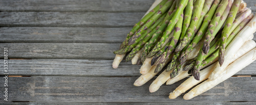 Asparagus on rustic gray wooden planks Canvas Print