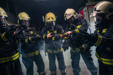 Team Of Firefighters In The Fi...