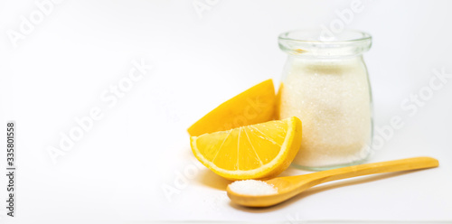 Fotografie, Obraz Citric acid on a white isolated background. Selective focus.