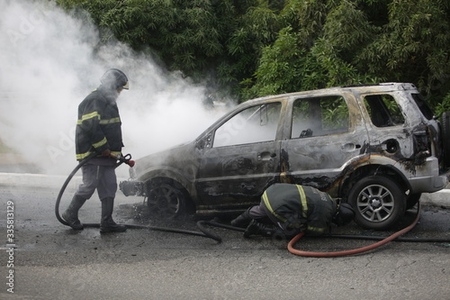 firefighters put out fire in an incendiary vehicle Canvas Print