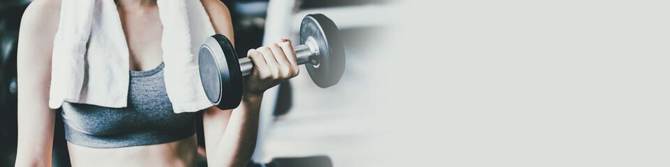 Fototapeta na wymiar Fitness woman doing exercise in gym