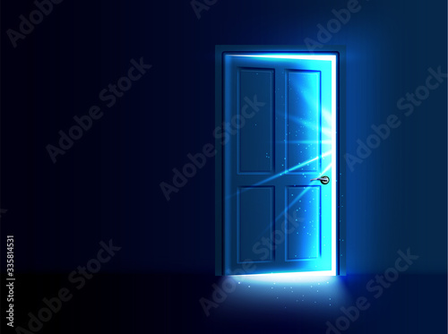 Photo Ajar door with light and rays coming out of the gap