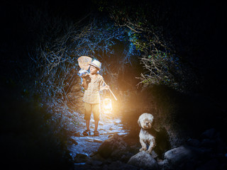 A young naturalist catched something into a jar. At dark the boy walks out of a cave with a lantern and a butterfly net, examines his catch. His faithful dog is nearby.