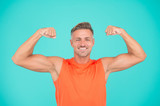 Stay strong in your life. Happy athlete show physical strength. Strong man flex arms blue background. Building strong biceps and triceps. Strong muscle workout. Sport and fitness. Get stronger
