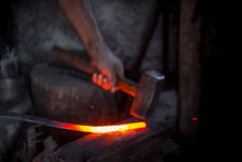Blacksmith's Hands At Work. In...