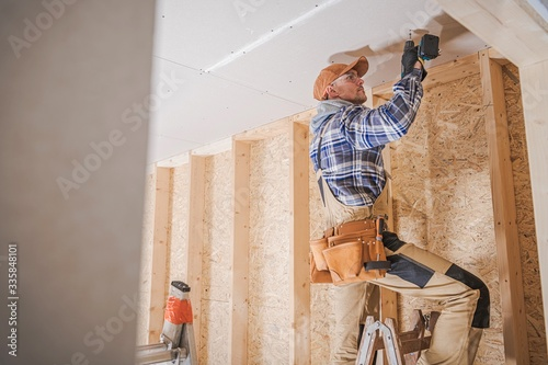 Photo Worker Attaching Drywall