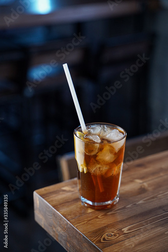 Modern classics mixology: cuba libre with rum and cola on wooden bar counter, at Wallpaper Mural