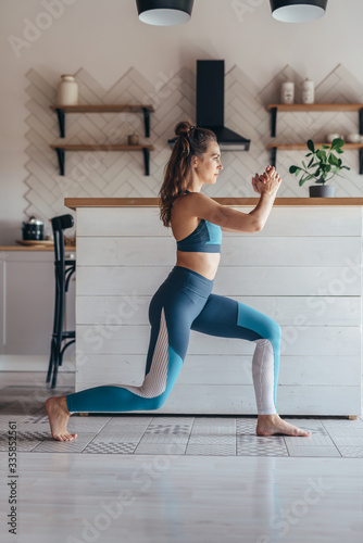 Fit woman exercising at home doing lunges exercise. Canvas