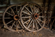 Old Wooden Wagon Wheels In Shed