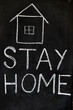 """Stay home save lives"" slogan due to Coronavirus pandemic outbreak around the world. Coronavirus Covid-19, quarantine motivational phrase. Stay home concept written on blackboard."