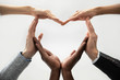 canvas print picture - Close up bottom view concept of diverse business people join hands forming heart. Show unity and support, protection of business. Multiracial colleagues involved in team building activity for charity.