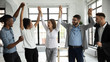 canvas print picture - Excited diverse business team celebrate hands up corporate victory together in office. Happy laughing multiethnic professionals group rejoice company victory, teamwork success win triumph concept.