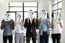 Diverse Business People Hiding...
