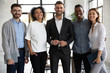 canvas print picture - Portrait of standing in row smiling diverse team looking at camera. Happy multiethnic corporate staff, young specialists, company representatives, bank workers photo shoot, HR agency recruitments.