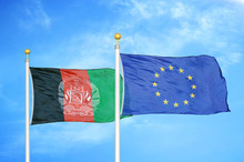 Afghanistan And European Union  Two Flags On Flagpoles And Blue Cloudy Sky