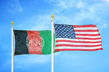 Afghanistan And United States  Two Flags On Flagpoles And Blue Cloudy Sky
