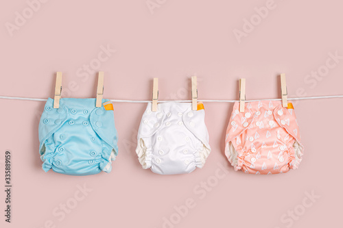 Tableau sur Toile Reusable cloth baby diapers drying on a clothes  line