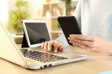 Woman Hands Using Multiple Devices At Home