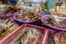 Plastic Bags Of Traditional Thai Dried Fish For Sale At A Food Market Stall, Thailand