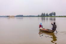 Fishing By Sampan At Dawn On The Thu Bon River, Hoi An, Vietnam