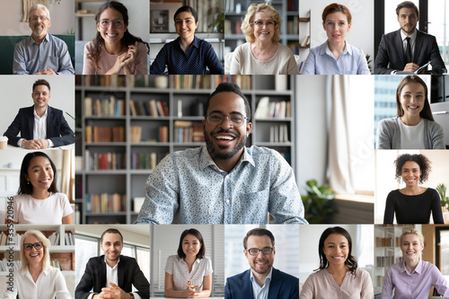 Obraz Many portraits faces of diverse young and aged people webcam view, while engaged in videoconference on-line meeting lead by african businessman leader. Group video call application easy usage concept - fototapety do salonu