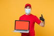 Delivery man in red cap blank t-shirt uniform mask gloves isolated on yellow background studio Guy employee work hold laptop pc computer Service quarantine pandemic coronavirus virus 2019-ncov concept