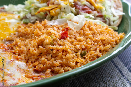 Fotografie, Tablou A closeup view of a portion of Mexican rice on an entree, in a restaurant or kitchen setting